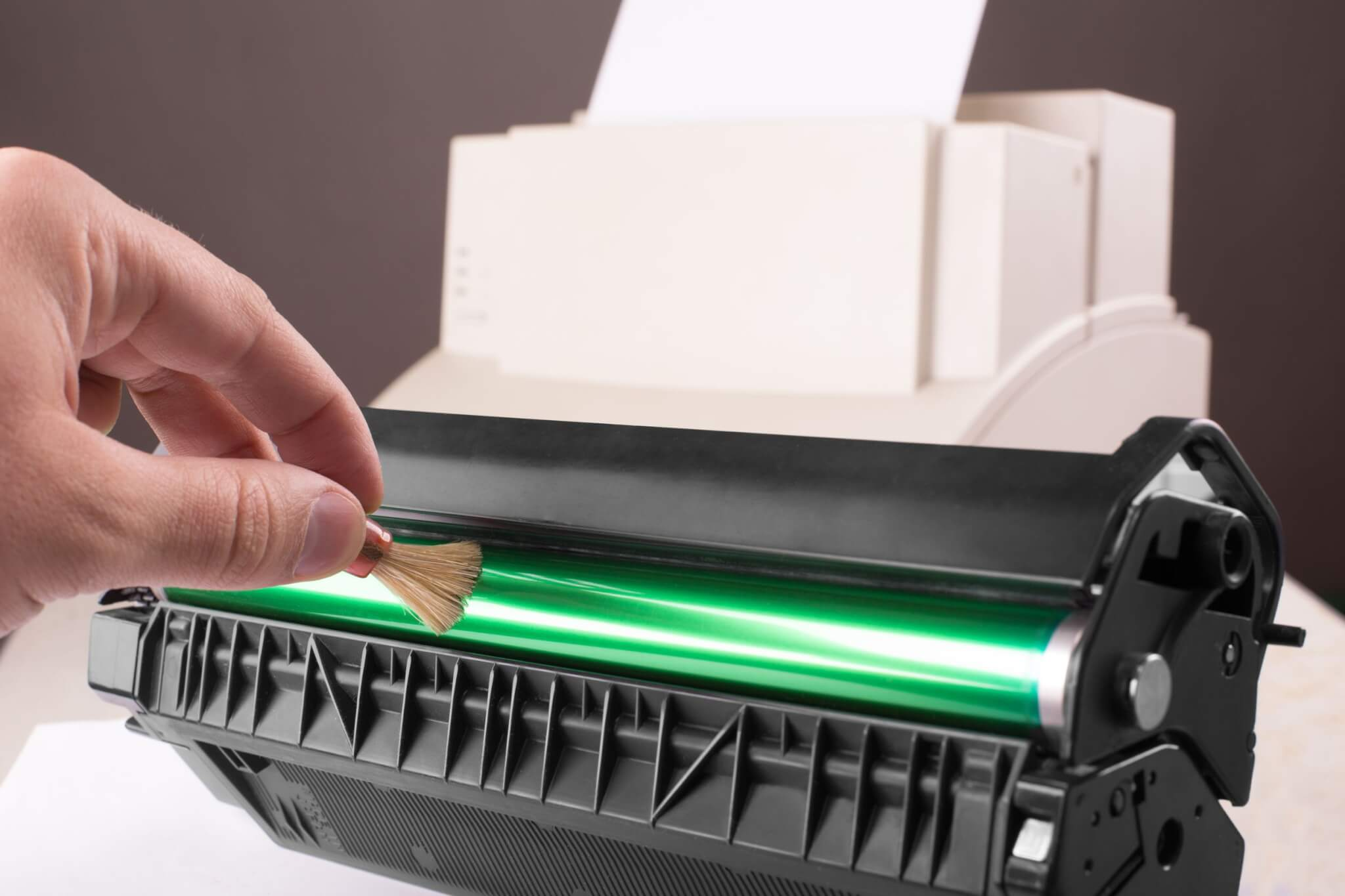 18910160 - technician hand cleaning printer toner cartridge