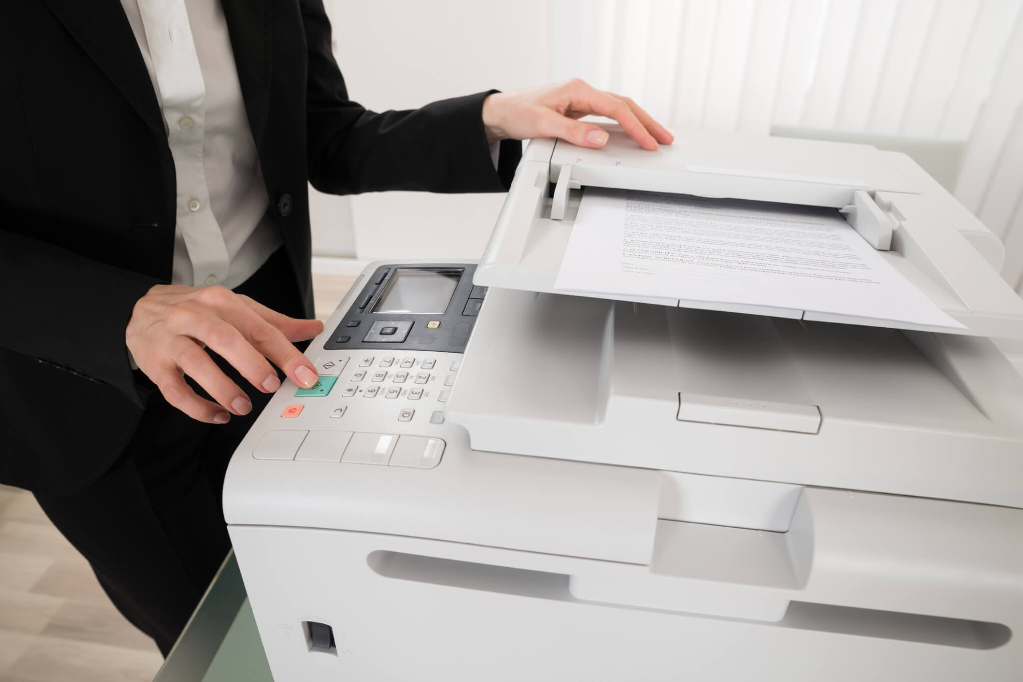 Businesswoman Pressing Printer's Button